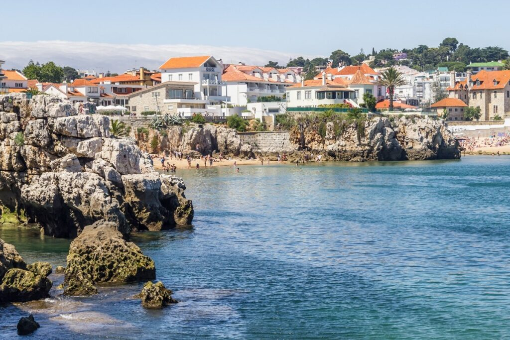 Beach, cliffs and houses in Cascais, Portugal