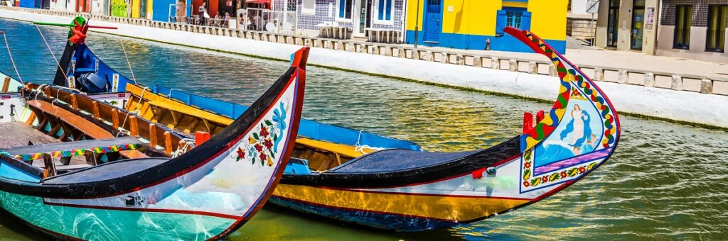 Colorful Art Nouveau Buildings And Boats In Aveiro